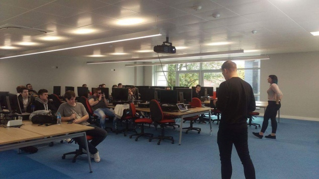 A picture of Lara and Tom talking to third year students at Edge Hill University