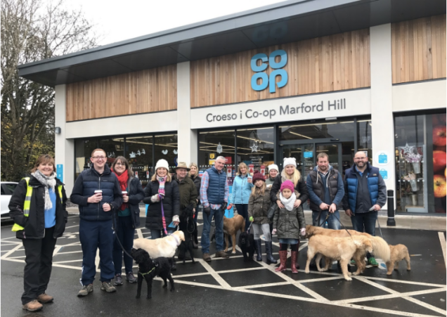 Members and their dogs outside the Co-op store in Wrexham before the dog walk.