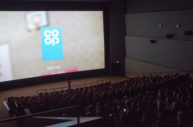 photograph of people watching the join us film at the screening