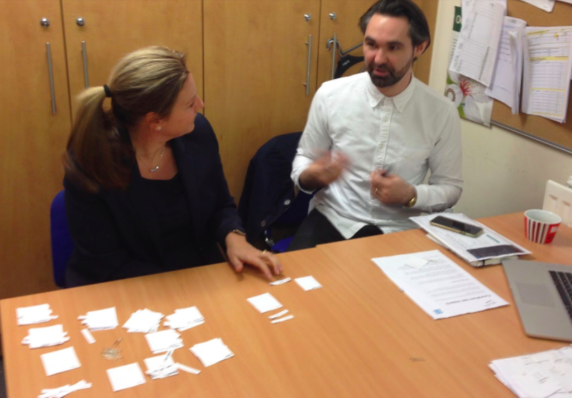 interaction designer Matt researching which content is most valuable to one of our colleagues with a paper prototype.
