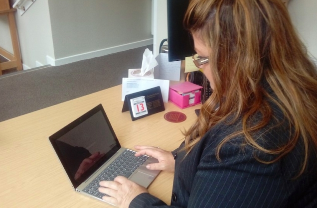 Photograph of Elizabeth, a colleague in the Edinburgh who is using the digital service on a tablet.
