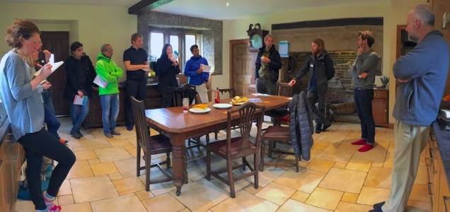 Photograph of a group of people standing in a farm kitchen where the team thought about prototyping communities.